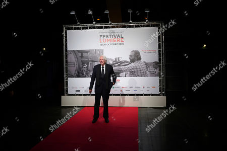 US actor Donald Sutherland poses for photographers as he arrives at the opening ceremony of the 11th Lumiere Festival, in Lyon, central France