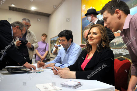 Stock Picture of Hungarian chess grandmaster Judit Polgar (2-R) and Russian chess grandmaster Vladimir Kramnik (C) sign autographs during the opening cermony of the 5th Global World Chess Festival at the Hungarian National Gallery in Budapest, Hungary, 12 October 2019.