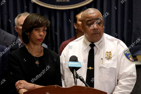 """Michael Harrison, Catherine Pugh. Baltimore Mayor Catherine Pugh, left, and Michael Harrison, center, acting commissioner of the Baltimore Police Department, listen to a reporter's question at an introductory news conference for Harrison in Baltimore. Police say a 2-year-old boy was wounded by gunfire when someone shot into a vehicle in an act of road rage, Saturday, Oct. 12. Harrison says the boy is in """"somewhat stable condition"""" and is expected to survive"""