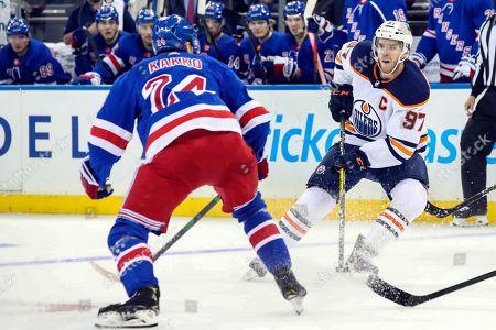 Connor McDavid, Kaapo Kakko. Edmonton Oilers center Connor McDavid (97) skates against New York Rangers right wing Kaapo Kakko (24) during the first period of an NHL hockey game, at Madison Square Garden in New York
