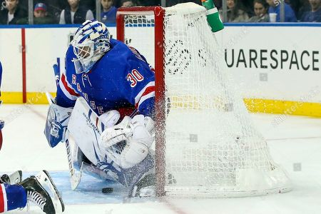 New York Rangers goaltender Henrik Lundqvist (30) is unable to stop a shot for a goal by Edmonton Oilers center Connor McDavid during the third period of an NHL hockey game, at Madison Square Garden in New York. The Oilers won 4-1
