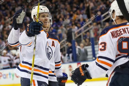 Edmonton Oilers center Connor McDavid (97) celebrates after scoring a goal against the New York Rangers during the third period of an NHL hockey game, at Madison Square Garden in New York. The Oilers won 4-1