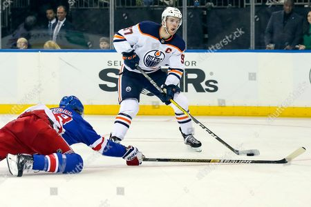 Connor McDavid, Marc Staal. Edmonton Oilers center Connor McDavid (97) skates against New York Rangers defenseman Marc Staal (18) during the third period of an NHL hockey game, at Madison Square Garden in New York. The Oilers won 4-1