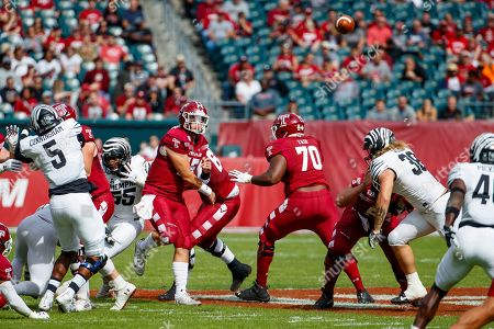 Temple quarterback Anthony Russo (15) throws a pass during the first half of an NCAA college football against Memphis, in Philadelphia. Temple won 30-28