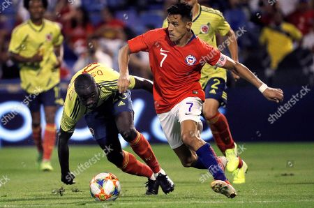 Chile's winger Alexis Sanchez (R) in action against Colombia's defender Davinson Sanchez during an international soccer friendly match between Chile and Colombia at Rico Perez stadium in Alicante, eastern Spain, 12 October 2019.