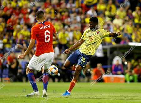 Stock Picture of Chile's defender Guillermo Maripan (L) in action against Colombia's midfielder Jefferson Lerma during an international soccer friendly match between Chile and Colombia at Rico Perez stadium in Alicante, eastern Spain, 12 October 2019.