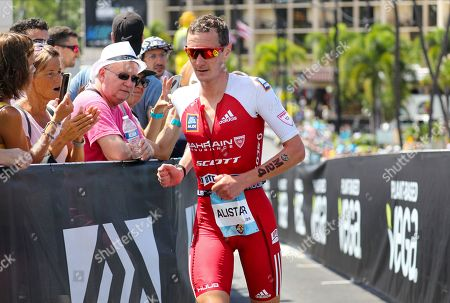 Stock Picture of Alistair Brownlee of the United Kingdom makes the turn from Palani Dr. to Kuakini Hwy. during the marathon segment of the 2019 Ironman World Championship Triathlon in Kailua-Kona, Hawaii, USA, 12 October 2019.