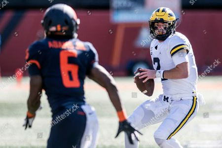 Michigan quarterback Shea Patterson (2) looks to throw as Illinois' Tony Adams (6) defends in the second half of an NCAA college football game, Saturday, Oct.12, 2019, in Champaign, Ill