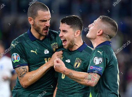 Italy's Jorginho (L) celebrates with his teammates Marco Verratti (R) and Leonardo Bonucci after scoring the 1-0  goal from the penalty spot during the UEFA EURO 2020 group J qualifying soccer match between Italy and Greece at the Olimpico Stadium in Rome, Italy, 12 October 2019.