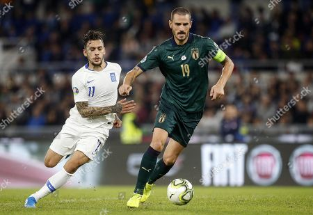 Italys captain Leonardo Bonucci (R) in action against Greece's Anastasios Donis (L) during the UEFA Euro 2020 group J qualifying soccer match between Italy and Greece at the Olimpico stadium in Rome, Italy, 12 October 2019.
