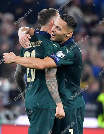 Italy's Federico Bernardeschi celebrates with hois teammate Danilo D'Ambrosio (R) after scoring 2-0 goal during the UEFA EURO 2020 group J qualifying soccer match between Italy and Greece at the Olimpico Stadium in Rome, Italy, 12 October 2019.