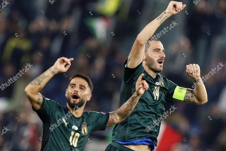 Italy's Lorenzo Insigne (L) and Leonardo Bonucci (R) celebrate their win after the UEFA Euro 2020 group J qualifying soccer match between Italy and Greece at the Olimpico stadium in Rome, Italy, 12 October 2019.