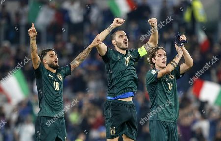 (L-R) Italy's Lorenzo Insigne, Leonardo Bonucci and Nicolo Zaniolo celebrate their win after the UEFA Euro 2020 group J qualifying soccer match between Italy and Greece at the Olimpico stadium in Rome, Italy, 12 October 2019.