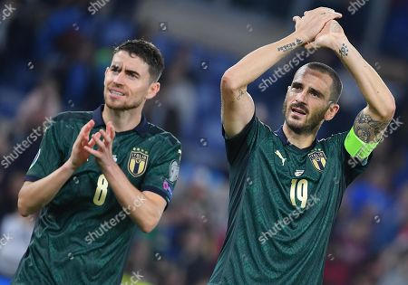 Italy's players, Leonardo Bonucci (R) and Jorginho, celebrate their win after the UEFA EURO 2020 group J qualifying soccer match between Italy and Greece at the Olimpico Stadium in Rome, Italy, 12 October 2019.