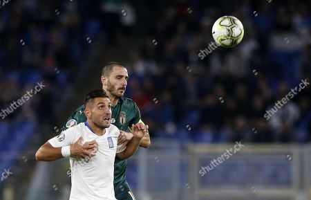 Italys captain Leonardo Bonucci (R) in action against Greece's Efthymis Koulouris (L) during the UEFA Euro 2020 group J qualifying soccer match between Italy and Greece at the Olimpico stadium in Rome, Italy, 11 October 2019.