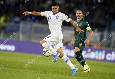 Greece's Tasos Bakasetas (L) in action against Italys captain Leonardo Bonucci (R) during the UEFA Euro 2020 group J qualifying soccer match between Italy and Greece at the Olimpico stadium in Rome, Italy, 11 October 2019.