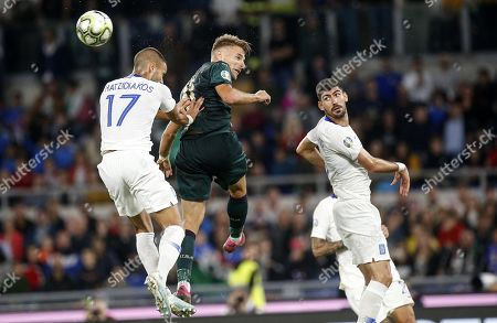 Italys Ciro Immobile (R) vies for the ball with Greece's Panteleimon Chatzidiakos (L) during the UEFA Euro 2020 group J qualifying soccer match between Italy and Greece at the Olimpico stadium in Rome, Italy, 12 October 2019.