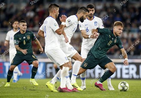 Italy's Ciro Immobile (R) in action during the UEFA Euro 2020 group J qualifying soccer match between Italy and Greece at the Olimpico stadium in Rome, Italy, 12 October 2019.
