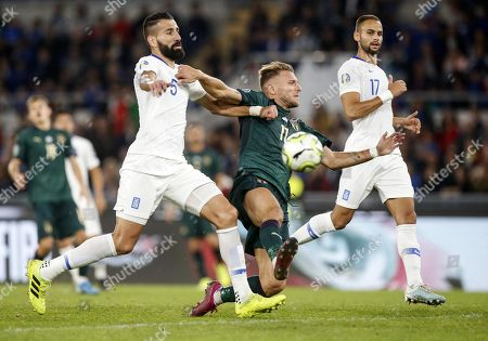 Italys Ciro Immobile (R) vies for the ball with Greece's Dimitris Siovas (L) during the UEFA Euro 2020 group J qualifying soccer match between Italy and Greece at the Olimpico stadium in Rome, Italy, 12 October 2019.