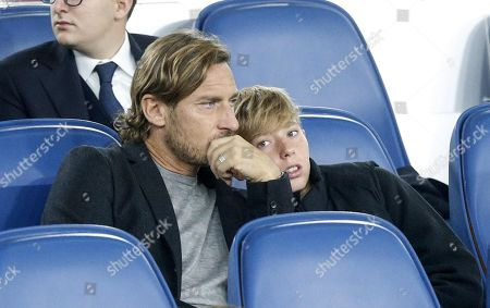 Stock Picture of Italian former soccer player and AS Roma legend Francesco Totti (L) with his son Cristian (R) during the UEFA Euro 2020 group J qualifying soccer match between Italy and Greece at the Olimpico stadium in Rome, Italy, 12 October 2019.