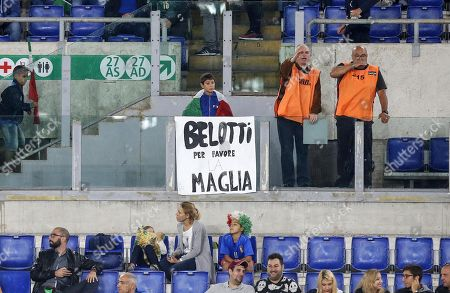 A child with a banner asks for the jersey of Italy's Andrea Belotti during the UEFA Euro 2020 group J qualifying soccer match between Italy and Greece at the Olimpico stadium in Rome, Italy, 12 October 2019.