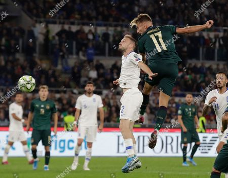 Italy's Ciro Immobile, right, heads the ball towards gaol during the Euro 2020 group J qualifying soccer match between Italy and Greece in Rome, Italy