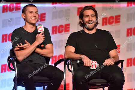 Tom Holland, Jake Gyllenhaal. Tom Holland, left, and Jake Gyllenhaal participate during a Q&A panel on day two at the Ace Comic-Con at the Donald E. Stephens Convention Center, in Rosemont, Ill