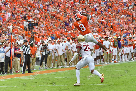 Clemson's Justyn Ross catches a pass over Florida State's Asante Samuel Jr. during the first half of an NCAA college football game, in Clemson, S.C