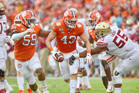 Clemson's Chad Smith (43) runs with the ball after recovering a fumble and is pressured by Florida State's Dontae Lucas during the first half of an NCAA college football game, in Clemson, S.C