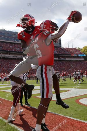 Demetris Roberston, George Pickens. Georgia wide receiver Demetris Robertson (16) celebrates with Georgia wide receiver George Pickens (1) after catching a pass for a touchdown in the second half of an NCAA college football game against South Carolina, in Athens, Ga