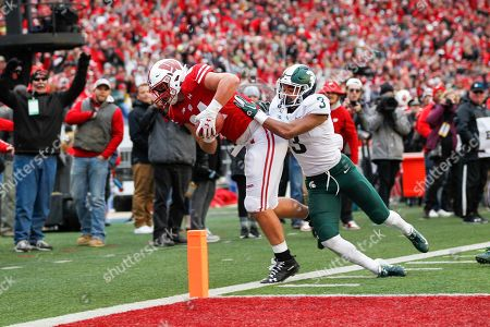 Wisconsin tight end Jake Ferguson makes a reception at the one-yard line against Michigan State safety Xavier Henderson (3) during the second half of an NCAA college football game, in Madison, Wis. Wisconsin won 38-0