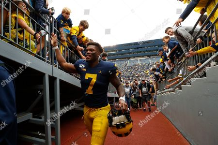 Michigan wide receiver Tarik Black (7) leaves the field after an NCAA college football game against Rutgers in Ann Arbor, Mich