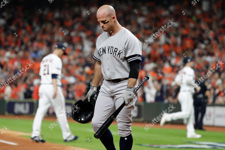 New York Yankees' Brett Gardner reacts after hitting into a double play to end the top of the second inning in Game 1 of baseball's American League Championship Series against the Houston Astros, in Houston
