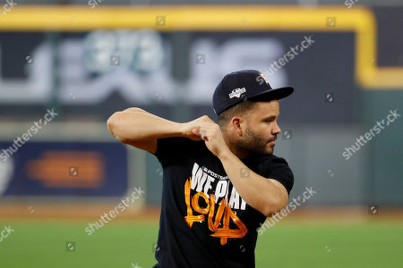 Stock Picture of Houston Astros second baseman Jose Altuve warms up during batting practice before Game 1 of baseball's American League Championship Series against the New York Yankees, in Houston