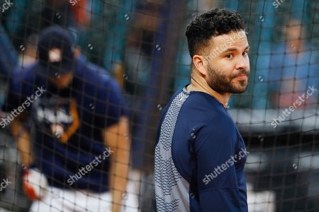 Houston Astros second baseman Jose Altuve watches during batting practice before Game 1 of baseball's American League Championship Series against the New York Yankees, in Houston