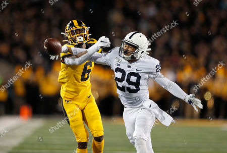 John Reid, Ihmir Smith-Marsette. Penn State cornerback John Reid, right, breaks up a pass intended for Iowa wide receiver Ihmir Smith-Marsette, left, during the first half of an NCAA college football game, in Iowa City, Iowa