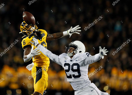 Penn State cornerback John Reid, right, breaks up a pass intended for Iowa wide receiver Ihmir Smith-Marsette during the first half of an NCAA college football game, in Iowa City, Iowa