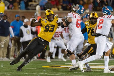 Missouri defensive lineman Tre Williams, left, pushes his way past Mississippi offensive lineman Michael Howard, right, during the third quarter of an NCAA college football game, in Columbia, Mo