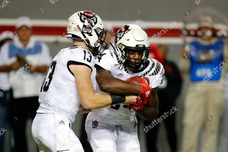 Devin Leary, Zonovan Knight. North Carolina State quarterback Devin Leary (13) hands the ball off to Zonovan Knight (24) during the first half of an NCAA college football game against the Syracuse in Raleigh, N.C