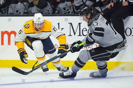 Stock Image of Tyler Toffoli, Craig Smith. Los Angeles Kings center Tyler Toffoli, right, moves the puck as Nashville Predators center Craig Smith puts pressure on him during the second period of an NHL hockey game, in Los Angeles