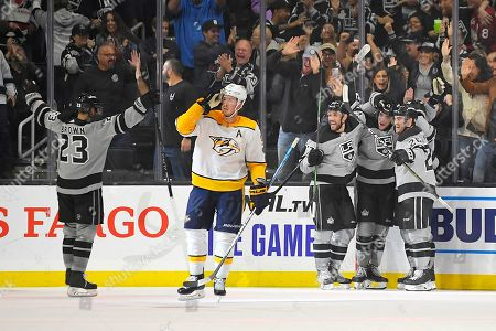 Dustin Brown, Ryan Johansen. Members of the Los Angeles Kings, right, celebrate a goal by left wing Alex Iafallo as Nashville Predators center Ryan Johansen skates away during the third period of an NHL hockey game, in Los Angeles. The Kings won 7-4