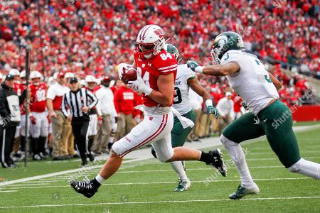 Wisconsin tight end Jake Ferguson and Michigan State safety Xavier Henderson (3) during the second half of an NCAA college football game, in Madison, Wis. Wisconsin won 38-0