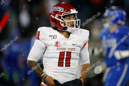 R m. Fresno State quarterback Jorge Reyna heads back to the bench after throwing an interception to Air Force linebacker Kyle Johnson, who scored during the second half of an NCAA college football game, at Air Force Academy, Colo