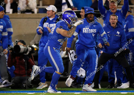 R m. Air Force linebacker Kyle Johnson celebrates after intercepting a pass and running it in for a touchdown against Fresno State during the second half of an NCAA college football game, at Air Force Academy, Colo