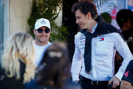 Finnish Formula One driver Valtteri Bottas (L) of Mercedes AMG GP and Mercedes AMG GP team chief Toto Wolff arrive at the paddock ahead of the Japanese Formula One Grand Prix in Suzuka, Japan, 13 October 2019.