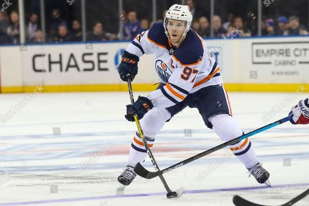 Edmonton Oilers center Connor McDavid shoots the puck during the third period of an NHL hockey game against the New York Rangers, at Madison Square Garden in New York. The Oilers won 4-1