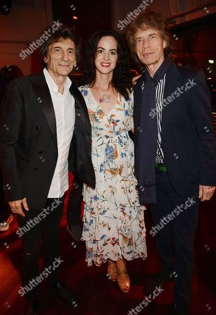 Stock Photo of Ronnie Wood, Sally Wood and Mick Jagger
