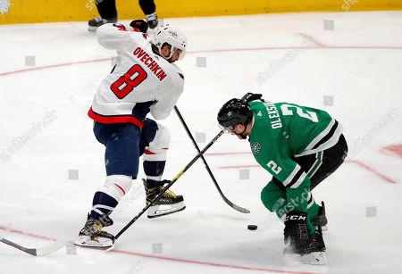 Alex Ovechkin, Jamie Oleksiak. Washington Capitals left wing Alex Ovechkin (8) works against Dallas Stars defenseman Jamie Oleksiak (2) in the third period of an NHL hockey game in Dallas