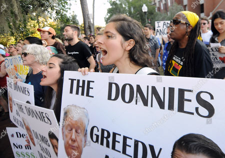 Demonstrators protest before a speech by Donald Trump, Jr. and his girlfriend, Kimberly Guilfoyle, who appeared at the University of Florida campus and spoke to a capacity crowd of about 850 students in what was billed as a keynote presentation.