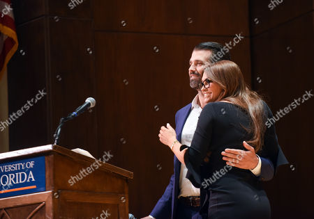 Donald Trump Jnr and his girlfriend, Kimberly Guilfoyle embrace each other during a speech at the University of Florida.